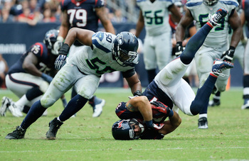Hi-res-182350668-owen-daniels-of-the-houston-texans-is-tripped-up-by-k-j_display_image