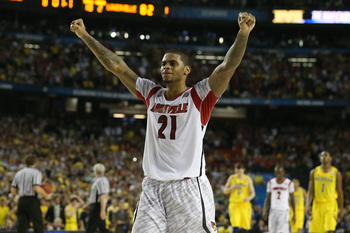 Chane Behanan celebrates the national title after dominating the paint against Michigan.