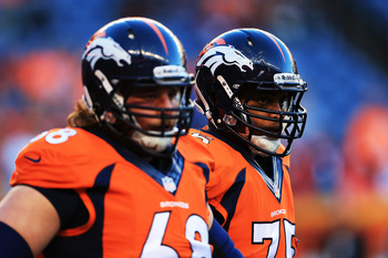 Hi-res-181698168-zane-beadles-and-chris-clark-of-the-denver-broncos-warm_display_image