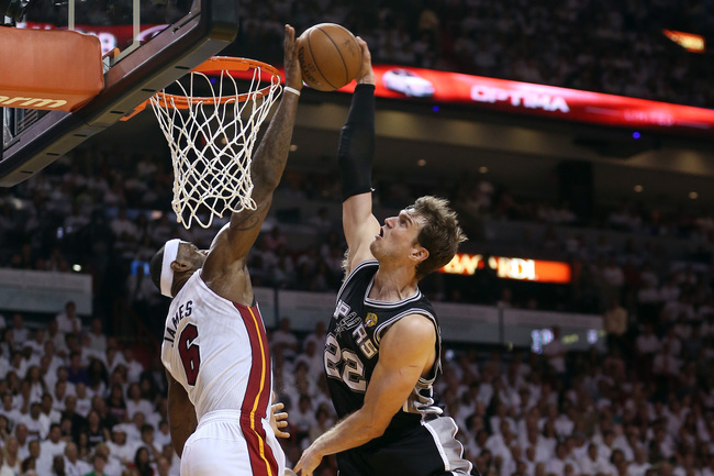 Hi-res-170256399-lebron-james-of-the-miami-heat-blocks-the-shot-of-tiago_crop_650