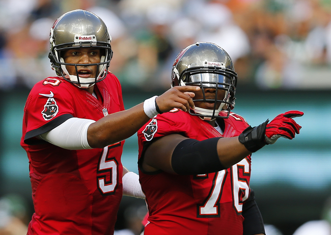 Hi-res-180159184-quarterback-josh-freeman-and-center-jeremy-zuttah-of_crop_650