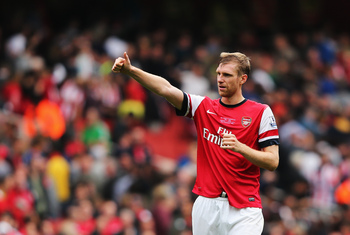 Hi-res-181536722-per-mertesacker-of-arsenal-celebrates-victory-after-the_display_image