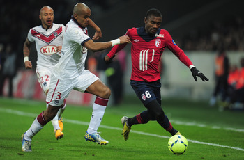 Hi-res-163027864-dit-henrique-of-bordeaux-battles-with-salomon-kalou-of_display_image