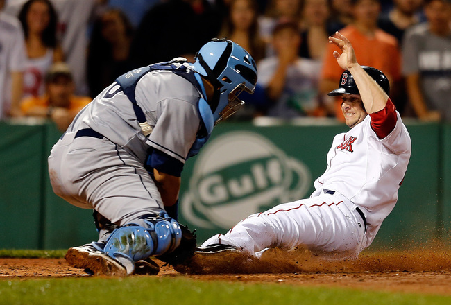Hi-res-175021884-jose-molina-of-the-tampa-bay-rays-tags-out-base-runner_crop_650x440