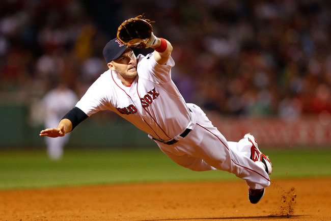Hi-res-180896352-stephen-drew-of-the-boston-red-sox-dives-but-comes-up_crop_650