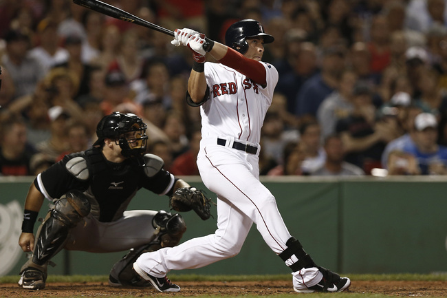 Hi-res-180058885-jacoby-ellsbury-of-the-boston-red-sox-follows-through_crop_650