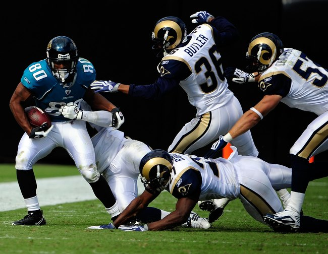 Hi-res-92174444-mike-thomas-of-the-jacksonville-jaguars-is-tackled-by_crop_650