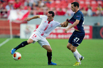 Hi-res-183000402-piotr-trochowski-of-sevilla-fc-competes-for-the-ball_display_image