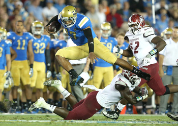 Hi-res-181516010-quarterback-brett-hundley-of-the-ucla-bruins-jumps-over_display_image