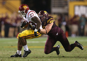 Hi-res-182601290-runningback-tre-madden-of-the-usc-trojans-is-tackled-by_display_image