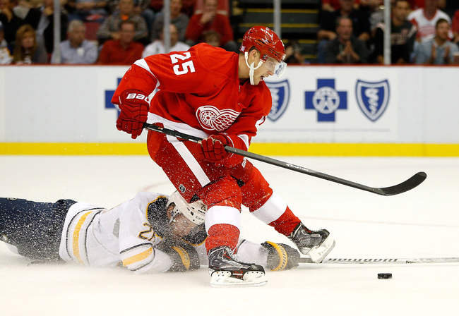 Hi-res-182956016-cory-emmerton-of-the-detroit-red-wings-is-tripped-up-by_crop_650