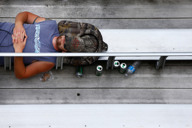 Hi-res-173409029-racing-fan-sleeps-on-the-bleachers-during-the-nascar_crop_650