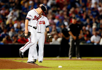 Hi-res-183013609-kris-medlen-of-the-atlanta-braves-looks-on-against-the_display_image