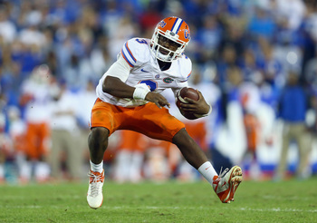 Hi-res-182263406-tyler-murphy-of-the-florida-gators-runs-with-the-ball_display_image