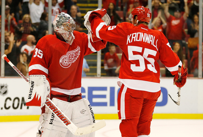 Hi-res-182960199-jimmy-howard-and-niklas-kronwall-of-the-detroit-red_crop_650x440