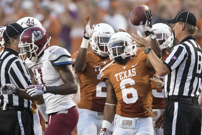Hi-res-179149639-quandre-diggs-of-the-texas-longhorns-celebrates-after_crop_650