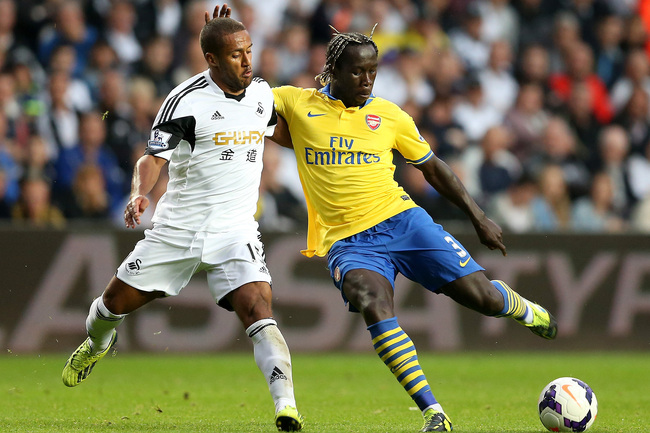 Hi-res-182123740-bacary-sagna-of-arsenal-in-action-with-wayne-routledge_crop_650