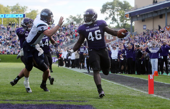Northwestern senior linebacker Damien Proby scoring a touchdown against Maine on Sept. 21.