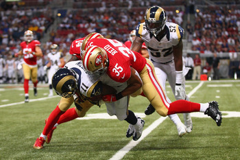Hi-res-181967292-tavon-austin-of-the-st-louis-rams-is-tackled-by-eric_display_image
