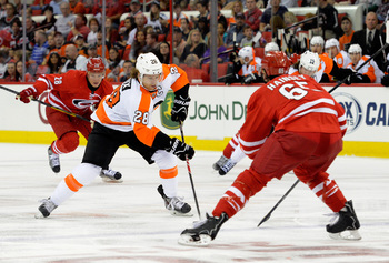 Hi-res-183472050-claude-giroux-of-the-philadelphia-flyers-moves-the-puck_display_image