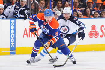 Hi-res-182619712-taylor-hall-of-the-edmonton-oilers-battles-for-the-puck_display_image