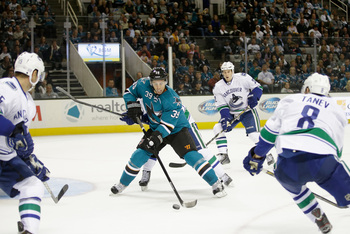 Hi-res-183016507-logan-couture-of-the-san-jose-sharks-controls-the-puck_display_image