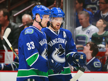 Hi-res-168243525-daniel-sedin-of-the-vancouver-canucks-talks-to-teammate_display_image