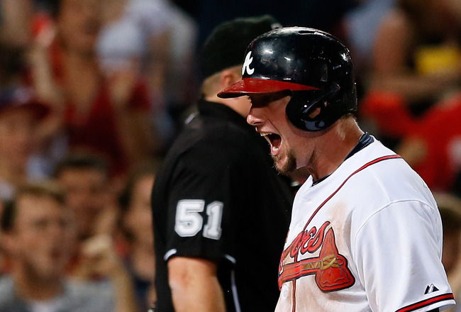 Hi-res-183124261-chris-johnson-of-the-atlanta-braves-celebrates-after_crop_650x440