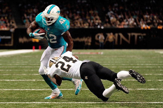 Hi-res-182568693-charles-clay-of-the-miami-dolphins-is-tackled-by-corey_crop_650