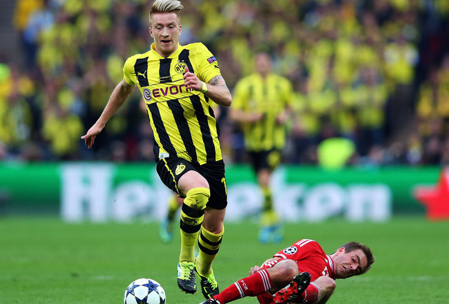 Hi-res-169474158-marco-reus-of-borussia-dortmund-in-action-with-philipp_crop_650x440