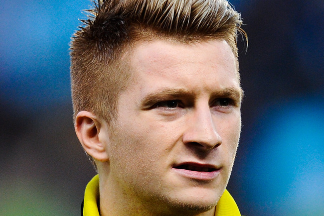 Hi-res-165534788-marco-reus-of-borussia-dortmund-looks-on-prior-to-the_crop_650