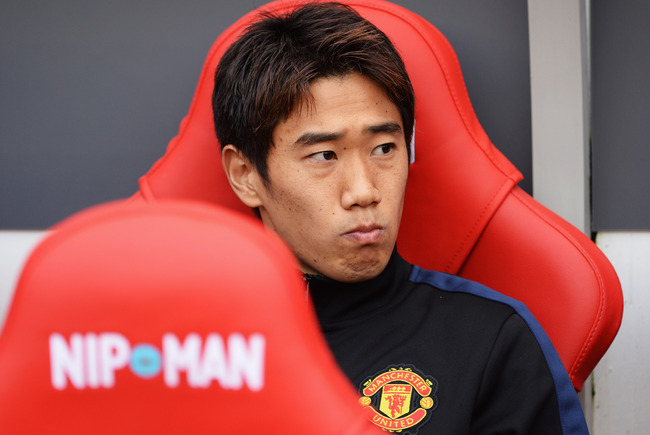 Hi-res-183158973-shinji-kagawa-of-manchester-united-looks-on-from-the_crop_650