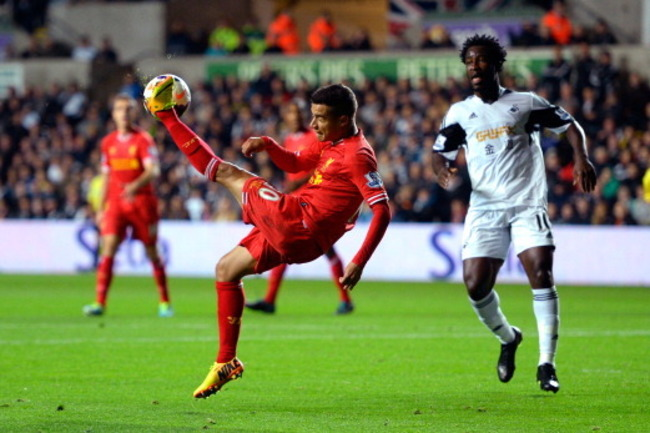 180789724-liverpool-player-phillipe-coutinho-trys-an-overhead_crop_650