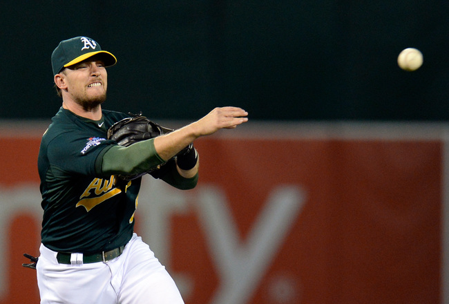 Hi-res-183126241-jed-lowrie-of-the-oakland-athletics-throws-out-jose_crop_650x440