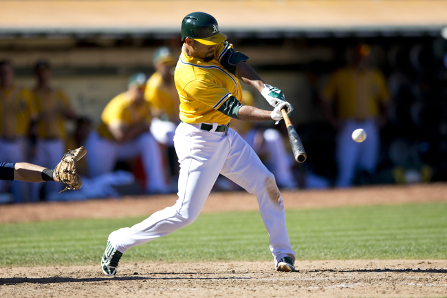 Hi-res-181607073-coco-crisp-of-the-oakland-athletics-hits-an-rbi-single_crop_650