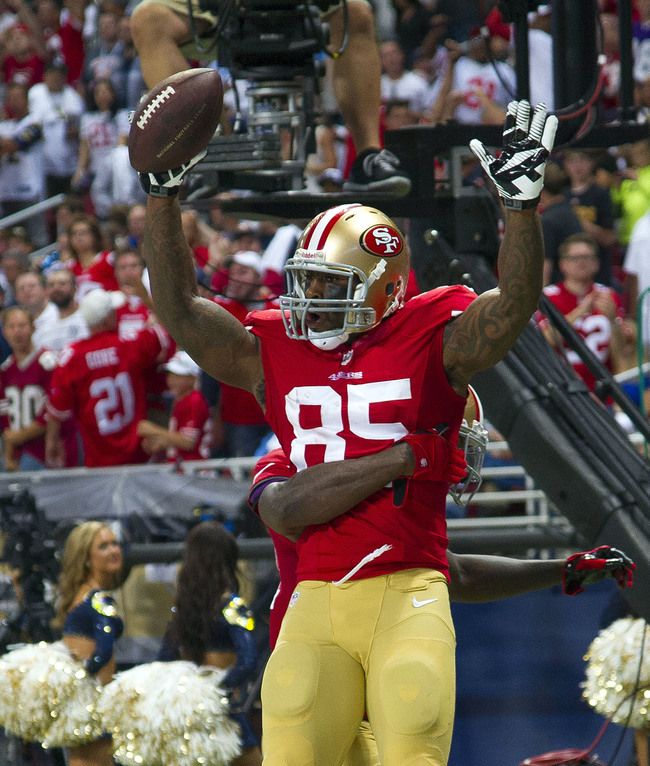 Sep 26, 2013; St. Louis, MO, USA; San Francisco 49ers tight end Vernon Davis (85) celebrates his touchdown against the St. Louis Rams during the second half at the Edward Jones Dome. The 49ers defeated the Rams 35-11. Mandatory Credit: Scott Rovak-USA TOD