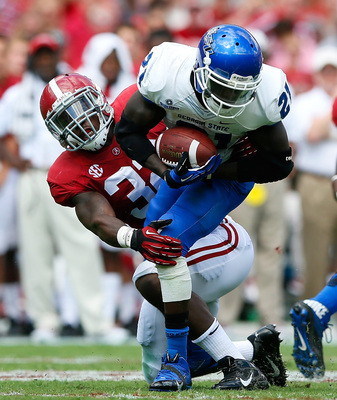 Hi-res-183163218-mosley-of-the-alabama-crimson-tide-tackles-travis-evans_display_image