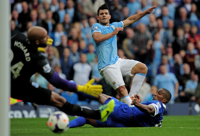 Hi-res-183151145-sergio-aguero-of-manchester-city-shoots-past-sylvain_crop_650x440