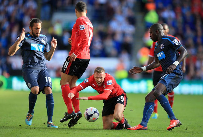 Hi-res-183156156-craig-bellamy-of-cardiff-city-is-brought-down-during_crop_650