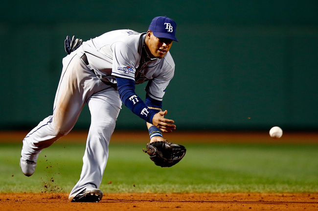 Hi-res-183182653-yunel-escobar-of-the-tampa-bay-rays-fields-a-ball_crop_650