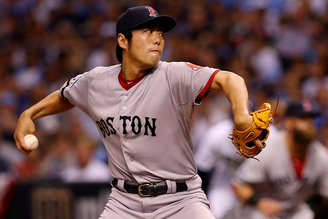 Hi-res-183676907-koji-uehara-of-the-boston-red-sox-pitches-against-the_crop_650
