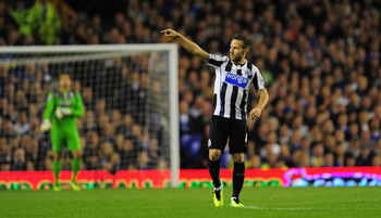 Hi-res-182551792-newcastle-player-yohan-cabaye-celebrates-by-pointing-at_display_image