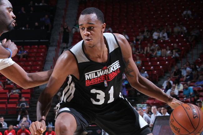 Hi-res-173969804-john-henson-of-the-milwaukee-bucks-dribbles-the-ball_crop_650