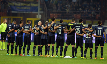 Hi-res-183169810-inter-milan-team-stand-for-a-minute-silence-for-victims_display_image
