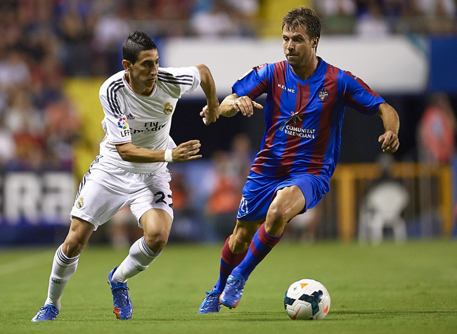 Hi-res-183167351-di-maria-of-real-madrid-competes-for-the-ball-with_crop_650