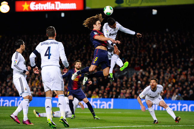 Hi-res-162772659-carles-puyol-of-fc-barcelona-jumps-for-the-ball-with_crop_650