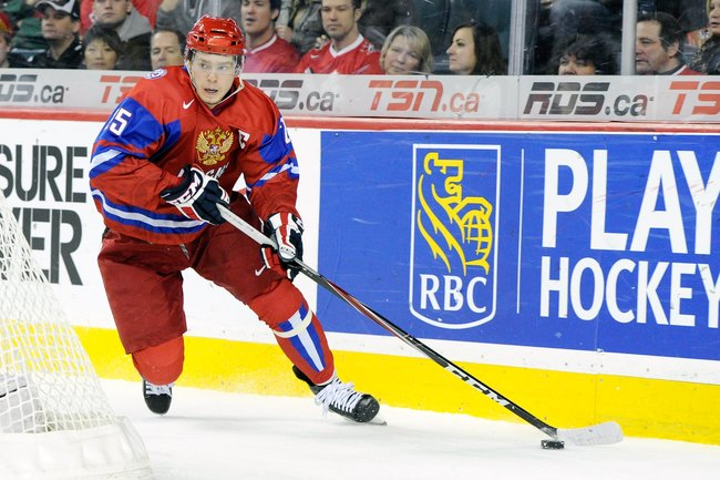 Hi-res-140422432-yevgeni-kuznetsov-of-team-russia-skates-with-the-puck_crop_650