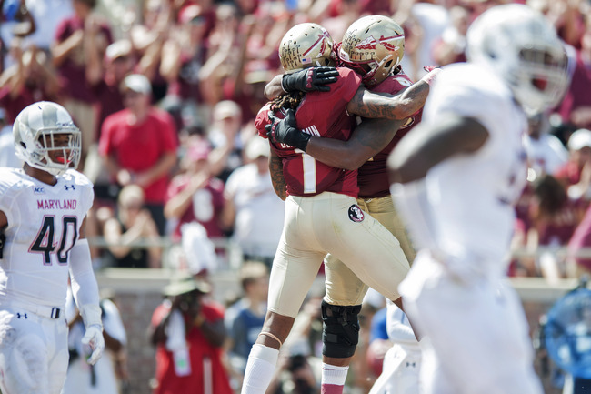 Hi-res-183170474-kelvin-benjamin-and-jameis-winston-of-the-florida-state_crop_650