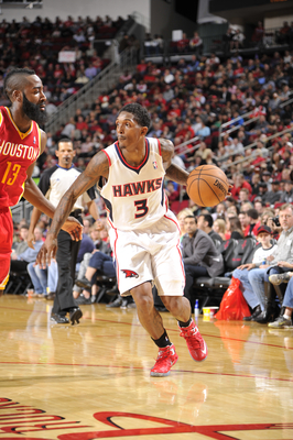 Hi-res-158840857-lou-williams-of-the-atlanta-hawks-drives-the-ball_display_image
