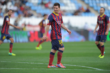 Hi-res-182582150-lionel-messi-of-fc-barcelona-looks-on-during-the-la_display_image